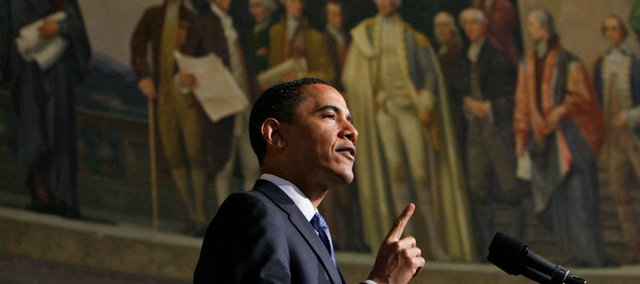 President Barack Obama delivers an address on national security, terrorism and the closing of Guantanamo Bay prison Thursday at the National Archives in Washington. Above him is a mural painted by Barry Faulkner in 1936 of the Constitution Convention depicting James Madison delivering the final draft of the Constitution to George Washington.