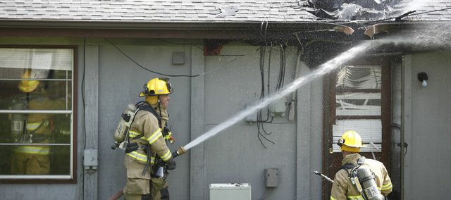 Firefighters douse a fire at 3302 Glacier Drive on Friday, May 22, 2009.