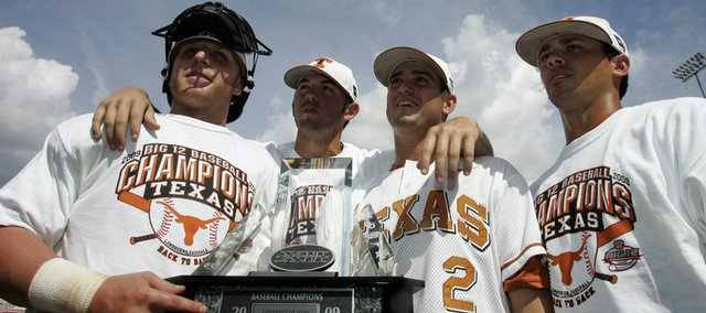 Longhorns, from left, Preston Clark, Austin Wood, Travis Tucker and Michael Torres hold the Big 12 baseball tournament championship trophy. Texas beat Missouri, 12-7, for the tournament title Sunday in Oklahoma City. Story on page 3B.