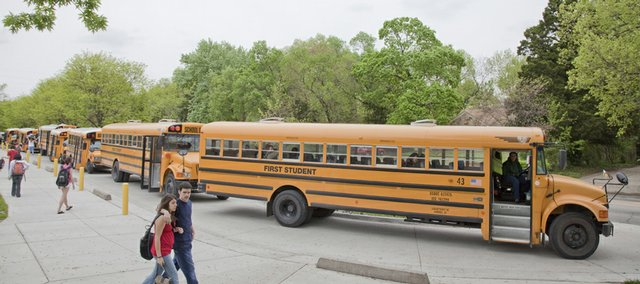 Lawrence High School Students board buses in this 2009 photo.