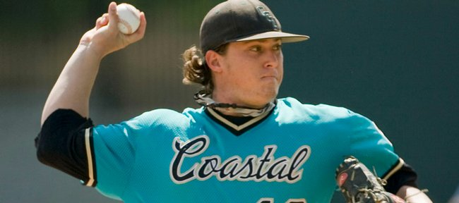 Coastal Carolina's Nick McCully pitches against Kansas University in the sixth inning. The Chanticleers beat KU, 11-3, Friday in an NCAA regional in Chapel Hill, N.C.