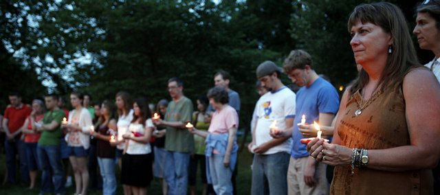 Mourners gather for a candlelight vigil at a park in Lawrence, Kan., Sunday, May 31, 2009. The vigil was for Dr. George Tiller who was shot to death earlier in the day.