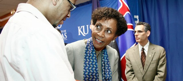 Newly appointed Kansas University chancellor Bernadette Gray-Little is welcomed by KU graduate Christopher Reine, Kansas City, Mo., on Saturday during Gray-Little's introduction to the university community at the Kansas Union, 1301 Jayhawk Blvd. At right is Jeff Aube, who served as a member of the chancellor search committee and is a professor of medicinal chemistry at KU.