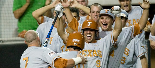 Texas' Preston Clark, left, celebrates with Connor Rowe (10) and Michael Torres (9) after Rowe scored the winning run in the 25th inning of a 3-2 victory over Boston College. The game that ended early Sunday in Austin, Texas, was the longest in NCAA history.