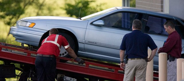 The vehicle allegedly owned by a suspect in the shooting death of Dr. George Tiller is loaded for transport from the Fred Allenbrand Justice complex Sunday, May 31, 2009, in New Century, Kan. Tiller, one of the nation's few providers of late-term abortions despite decades of protests and attacks, was shot and killed Sunday in a church where he was serving as an usher.