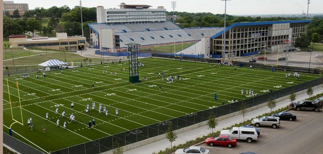 The Kansas University football team runs through drills during an evening practice in this  Aug. 7, 2008, file photo.