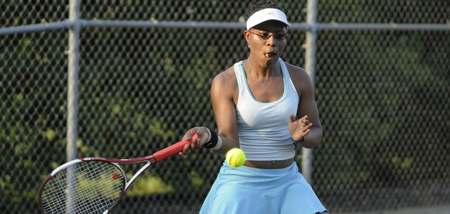 Lawrence resident Risi Oseni returns a shot during the Lawrence Open tennis tournament. Oseni won her women's 4.0 singles division at the event Friday at Lawrence Tennis Center.