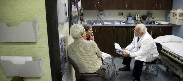 Dr. Ron Stephens, Lawrence Memorial Hospital oncologist, right, consults with Lawrence residents Bill and Martha Curtis in the oncology center at LMH in 2009.