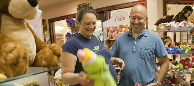 James Kelley and his wife, Shawn, Pomona, look over baby toys in the Lawrence Memorial Hospital gift shop before a visit to their doctor. The couple are expecting twin boys this month. James received a life-saving bone marrow transplant in 2002.