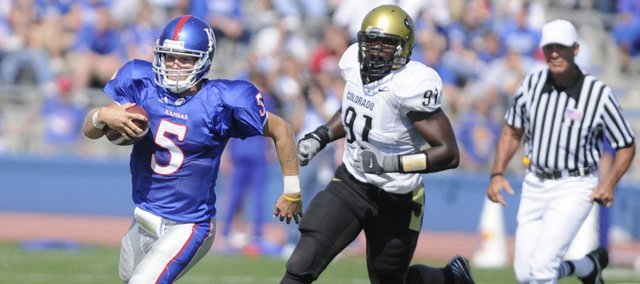 Kansas quarterback Todd Reesing runs to the sideline in this Oct. 11, 2008, file photo against Colorado at Memorial Stadium. Reesing, who will return as a senior this fall, is expected to lead a potent KU offense.