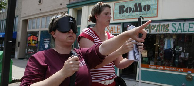 Students from Missouri State University try to navigate the streets of Lawrence blindfolded as part of a certification program for teachers of the visually impaired and orientation and mobility specialists.