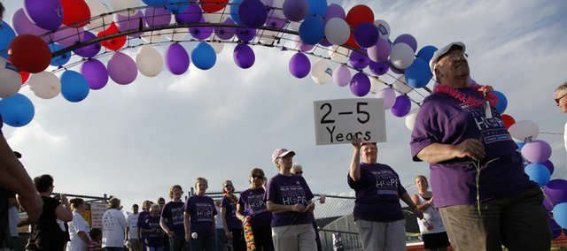 The 2009 Relay For Life of Douglas County started off with survivors leading the way to the track under an arch of balloons. Teams participated in the 12-hour event by walking around the track to celebrate cancer survivors, support current patients, and remember loved ones.