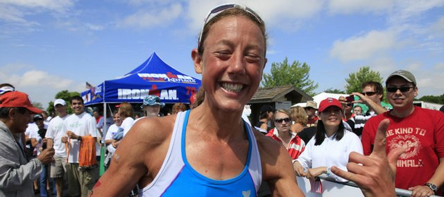 Chrissie Wellington shows her excitement after winning the women's division of Sunday's Ironman 70.3 Kansas at Clinton Lake.