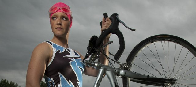 Meghan Graham will compete in the Ironman 70.3 kansas triathlon today at Clinton State Park. Graham has raced in three triathlons this year, but nothing close to the distance of today's half Ironman.