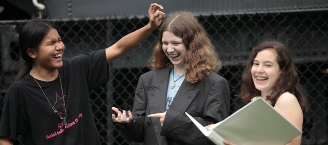 "From left, Rob Parker-Ortley, 16, Anna Taylor, 14, and Sarina Farb, 15, all members of the Lawrence Youth Ensemble, rehearse a scene from ""John Brown,"" one of the skits from their original play, ""Home on the Road,"" in Watson Park. The ensemble will give three performances in parks around town Friday through Sunday. The nine-member cast wrote the play, a series of vignettes about Lawrence."