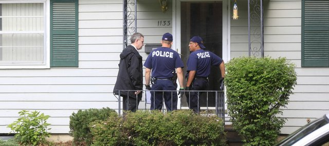 June 2009: Police Chief Ron Olin along with Lawrence Police work the scene of a possible attempted murder in the 1100 block of Hilltop Drive about 8 a.m. Tuesday. The police were called to the home about 1:10 a.m after a Lawrence woman reported that she had been beaten with a bat.