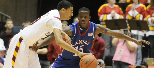 Kansas guard Tyshawn Taylor defends Iowa State guard Diante Garrett during the first half of the Jayhawks' game Jan. 24 at Hilton Coliseum in Ames, Iowa.