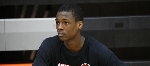 Ames High School basketball player Harrison Barnes looks on during practice at the school in Ames, Iowa. The 6-foot-7 standout has been pegged by many as the top prospect in the country.