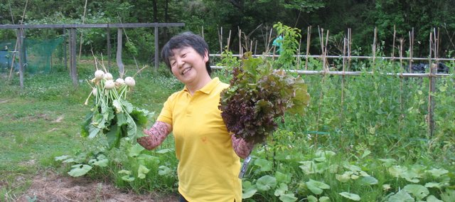 Yoko Wako, who farms with husband Noboru, is part of the Global Partners for Local Organic Foods, an exchange program that has brought 10-member group from Japan to Lawrence for an information-gathering trip that will include farm tours, a forum on local organic foods in Japan and a cooking demonstration at the Lawrence Farmers' Market.