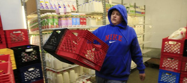 Keeping cool Tuesday was no problem for Checkers Foods employee Brett Anderson, 17, who donned a hooded sweatshirt to stock items in the 35-degree dairy case. Temperatures outside were another story, with heat index values in the triple digits. Today is expected to be a scorcher as well.