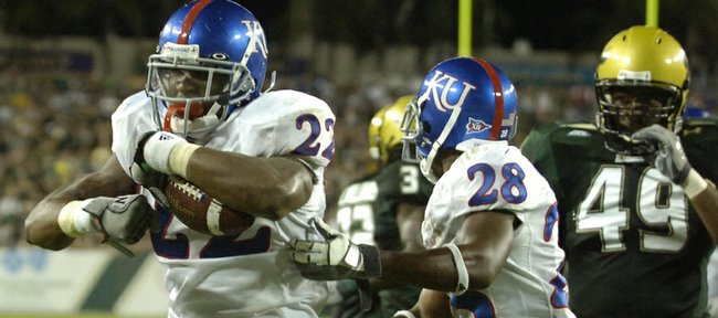 Kansas running back Angus Quigley flexes after scoring a touchdown against South Florida in this Sept. 12, 2008, file photo in Tampa, Fla.