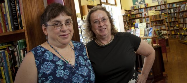 Lawrence resident Caryn Mirriam-Goldberg, left, will take the reins as Kansas Poet Laureate as Denise Low, right, finishes her two-year term. The two are pictured at the Raven Bookstore, 6 E. Seventh St.