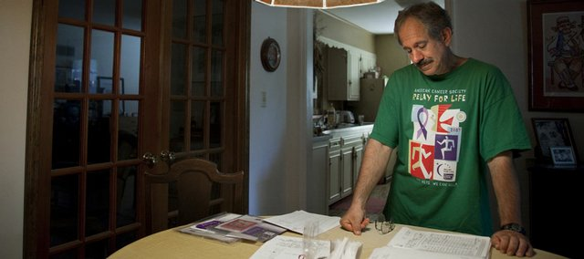 Relay For Life fundraiser Bob Silipigni, who reached his career fundraising goal of $100,000 this year, talks Tuesday at his Lawrence home about how his late mother, Flora C. Silini, watched her own father and brother die of cancer. Silipigni collected $23,775 this year for Relay For Life, sending his career fundraising total to $106,366.63.