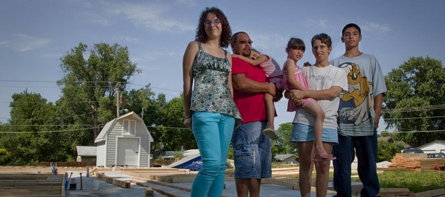 A new Habitat for Humanity home is under construction for the Mendoza family of Lawrence. Pictured at the site of their new house from left are family members Haley Weeks, Luis Mendoza, Morgan Mendoza, Tayiah Mendoza, with her mother, Tammy Mendoza and Domonic Mendoza.