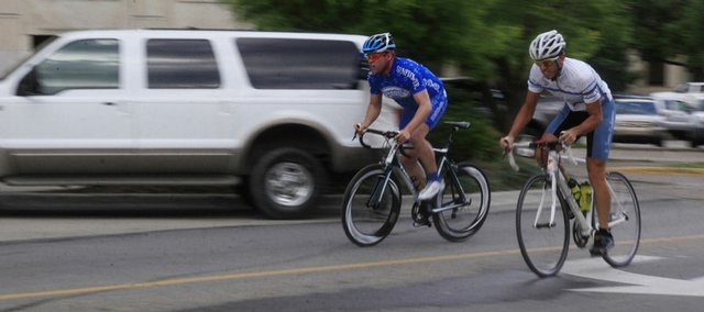 Lawrence residents Dan Hughes, left, and Adam Mills work on their sprints last Thursday in downtown Lawrence. Hughes and Mills were training for the Tour of Lawrence, set to take place Friday-Sunday in downtown Lawrence and at Kansas University's campus.