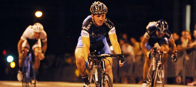 Chad Cagel crosses the finish line of an early heat of the Eldridge Hotel Street Sprint. The sprint Friday night up Seventh Street was the first event in the three-day Tour of Lawrence.