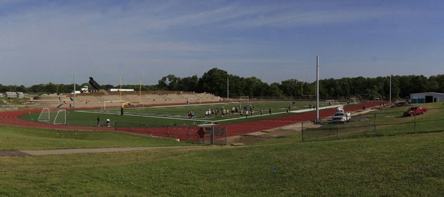 Workers continue installing the block building for the stands at the new Free State field on Tuesday.