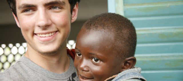 Geoff Shepard says he hopes the missionary work he does will make a difference in the lives of others — even something as simple as getting to know a child. Here, he bonds with an orphan in Cameroon in June 2008.