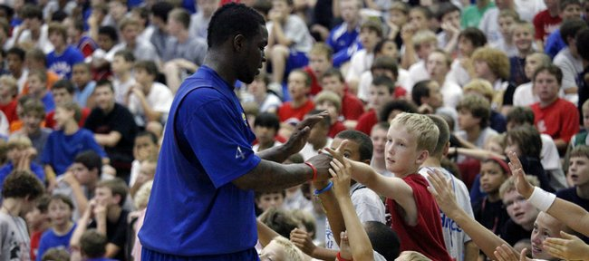 Sherron Collins high-fives youths at the Bill Self basketball camp June 10 at Horejsi Center. Collins spoke Thursday about being relieved to find out his mother, Stacey Harris, wouldn't be diagnosed with cancer. Collins has been back and forth to Chicago to visit her all summer.