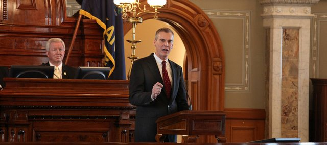 Governor Mark Parkinson addresses the state legislature during a joint session of the house and senate in the house chamber of the capital building in this April 2009 file photo.