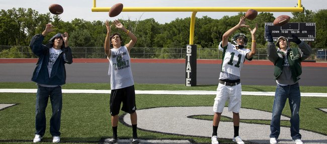 Free State senior wide receiver Bo Schneider is pictured above catching the football in spring, summer, fall and winter seasons. A recent Kansas State High School Activities Association rule change permits coaches to interact with their players year around. A handful of college coaches that recruit heavily in Kansas are in favor of the rule change.