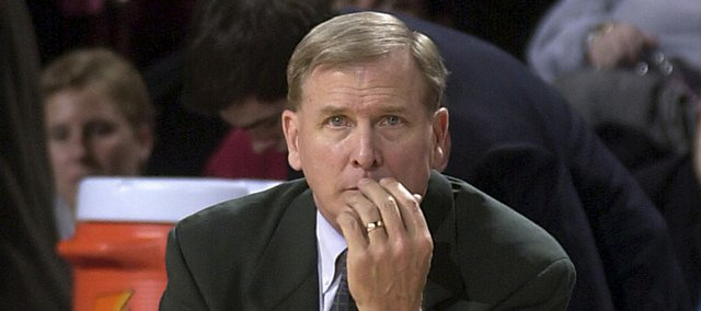 In this Feb. 8, 2003, file photo, then-Baylor coach Dave Bliss watches as his Baylor team plays against Oklahoma during a game in Norman, Okla. After spending several years hiding from the disgrace of presiding over a program stained by a shocking murder and financial shenanigans, Bliss is living back in Texas.