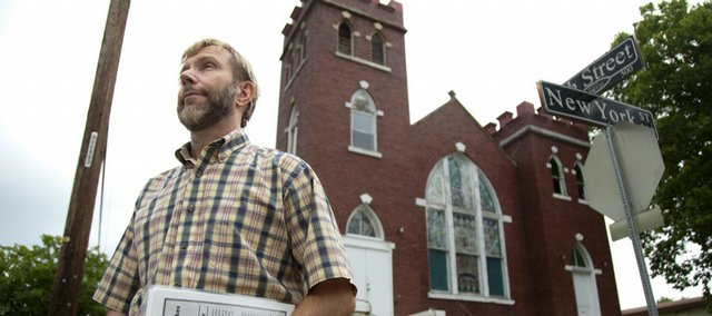 Rick Sheridan, an assistant communications professor at Wilberforce University in Ohio, is pictured Tuesday in front of St. Luke's AME Church, where Langston Hughes was a member in his childhood. Sheridan, a Lawrence native who is visiting for the summer, has created a number of historic markers that he hopes to place around Lawrence.