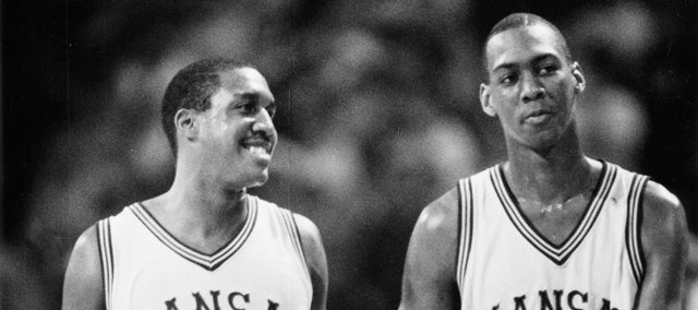 Kansas University basketball teammates Calvin Thompson (#35) and Danny Manning (#25) congratulate each other in this 1985 file photo. Thompson and Manning were part of a 1985-1986 squad that earned the program's 1,300th victory by defeating SIU-Edwardsville in December.