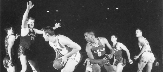 The 1951-1952 Kansas University basketball team practices in this file photo. The team, which featured Bill Lienhard (#11), Clyde Lovellette (#16), LaVannes Squires (#6) and Charlie Hoag (#5), notched the program's 700th victory by defeating Missouri in a game played in Kansas City, Mo. The Jayhawks later went on to defeat St. John's in the national championship game, 80-63.