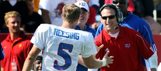 Kansas University receivers coach David Beaty, right, congratulates Todd Reesing on a play in this file photo from last season. Beaty has established himself as one of the top recruiters in the Big 12 Conference.