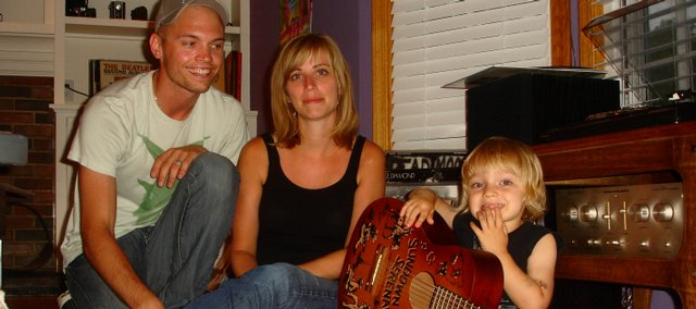 Josh Berwanger, his wife, Heidi-Lynne Gluck, and their son, Oliver, 2, are surrounded by some of their musical gear. The family, formerly of Lawrence, has drastically rearranged their lives since Oliver was diagnosed with type 1 diabetes. They've dedicated any proceeds from their music performances to juvenile diabetes research, including a benefit concert Saturday night at Jackpot Music Hall, 943 Mass.