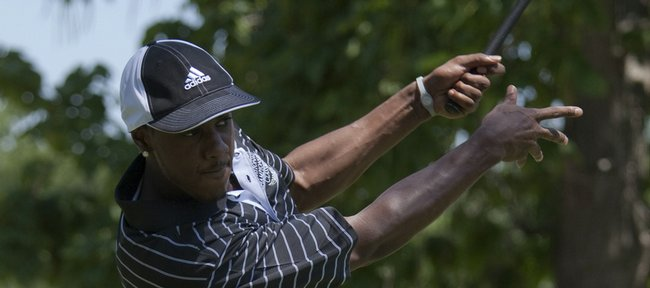 Miami Heat and former KU basketball player Mario Chalmers tees off to start the National Championship Classic. Chalmers will not be able to participate in the 2010 edition because of a high ankle sprain.