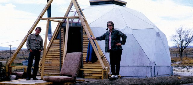 Clark Richert, left, a Kansas University graduate who co-founded Drop City, stands outside a geodesic dome that served as a kitchen for the commune in this 1965 photo. At right is fellow Drop City resident Carol DiJulio.