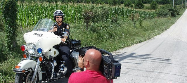 "Crewmen film a scene in Raina Bauman's music video for ""Harley Man"" in this contributed photo. Part of the footage was shot at the Lake Stop gas station just west of Bonner Springs."