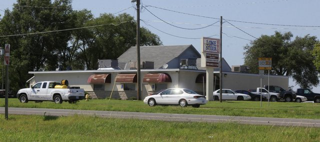 The building that formerly housed Lone Steer BBQ and Don's Steakhouse was previously proposed as a site for the Lawrence Community Shelter.