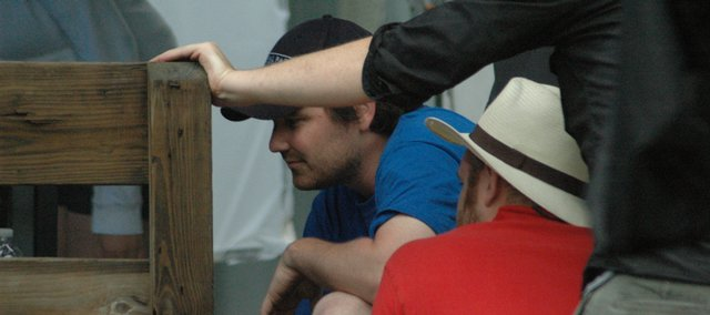 "Director Joe Saunders reviews a shot on the Eudora set of ""Sweet Little Lies."""