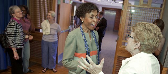 Newly-appointed Kansas University chancellor Bernadette Gray-Little is greeted by her colleague, Kathleen McCluskey-Fawcett, director of the honors program at KU, Saturday, May 30, 2009 at the Kansas Union.
