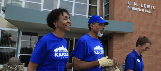 KU's new chancellor, Bernadette Gray-Little, and her husband, Shade Little, were on Daisy Hill Sunday morning to meet students and lend a hand with moving. With them was Vice Provost Marlesa Roney, right, who led a tour of the residence halls.