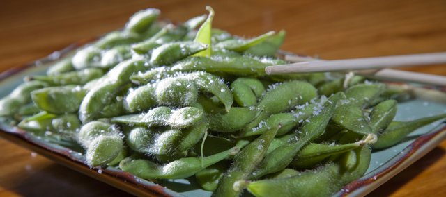 Edamame is a dish of green soybeans, steamed and served as appetizers at Zen Zero, 811 Mass. It is packed with protein and fiber as well as iron, calcium, vitamin K and folate.