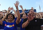Kansas University's new chancellor Bernadette Gray-Little, along with KU men's basketball coach Bill Self, wave the wheat with thousands of new students at Traditions Night on Monday at Memorial Stadium.